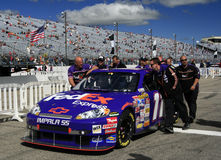 NASCAR - moving into position. Denny Hamlin's team members push thier car towards their starting position on pit road before the first race for the 2007 NASCAR Royalty Free Stock Images