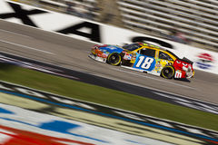 NASCAR:  Nov 06 AAA Texas 500. FORT WORTH, TX - NOV 06, 2010:  Kyle Busch (18) brings his M&M's Toyota through the frontstretch during a practice session for the Stock Images