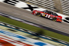 NASCAR:  Nov 06 AAA Texas 500. FORT WORTH, TX - NOV 06, 2010:  Tony Stewart (14) brings his Office Depot Chevrolet through the frontstretch during a practice Royalty Free Stock Image
