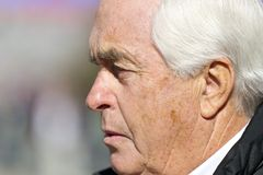 NASCAR:  Nov 06 AAA Texas 500. FORT WORTH, TX - NOV 06, 2010:  Team owner, Roger Penske, walks down pit road before a practice session for the AAA Texas 500 race Royalty Free Stock Photo