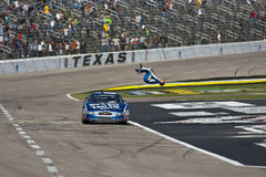 NASCAR:  Nov 06 O'Reilly Auto Parts Challenge. FORT WORTH, TX - NOV 06, 2010:  Carl Edwards holds off Kyle Busch and the rest of the field to win the O'Reilly Stock Image