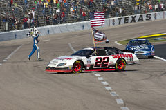NASCAR:  Nov 06 O'Reilly Auto Parts Challenge. FORT WORTH, TX - NOV 06, 2010:  Brad Keselowski (22) clinches the Nationwide Series title as Carl Edwards (60) Stock Photos