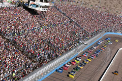 NASCAR:  November 15 Checker O'Reilly Auto 500. Avondale, AZ - November 15, 2009:  The NASCAR Sprint Cup Series teams take to the track for the Checker O'Reilly Stock Photos