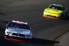 NASCAR: November 10 Whelen Trusted to Perform 200. November 10, 2018 - Avondale, Arizona, USA: Austin Cindric 22 brings his car through the turns during the royalty free stock photo