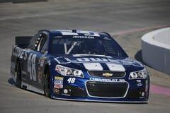 NASCAR 2013:  O RELEVO da DOR DE CABEÇA do PRESENTE da série do copo da sprint DISPAROU em 500 Imagem de Stock