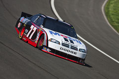 NASCAR:  Oct 08 Pepsi Max 400. FONTANA, CA - OCT 08, 2010:  Sam Hornish, Jr. brings his Mobil 1 Dodge through the turns during a practice session for the Pepsi Royalty Free Stock Photos