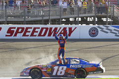 NASCAR:  Oct 09 CampingWorld.com 300. FONTANA, CA - OCT 09, 2010:  Kyle Busch wins for the 12th time this season, winning the CampingWorld.com 300 race at the Royalty Free Stock Image