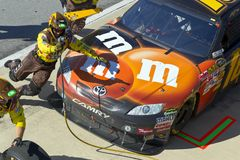 NASCAR:  Oct 31 AMP Energy Juice 500. TALLADEGA, AL - OCT 31, 2010:  Kyle Bush brings his M&Ms Toyota in for service duirng the AMP Energy Juice 500 race at the Royalty Free Stock Image