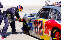NASCAR - Pit Crew Fixing Left Front End Royalty Free Stock Photo