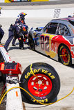 NASCAR - Pit Crew Tire Damage And Repair Stock Image