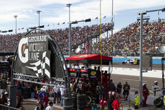 NASCAR pit road at Phoenix International Raceway. Pit row and fans Royalty Free Stock Photos