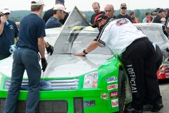 NASCAR racing. NASCAR official measuring racing cars to see if they comply to NASCAR rules Royalty Free Stock Photography
