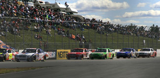 NASCAR - Racing the back stretch in NH Stock Images