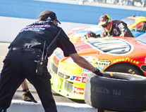 NASCAR's Jeff Gordon's pit stop on pit lane. NASCAR Driver Jeff Gordon's pit crew install four fresh tires on his Sprint Cup race car during the Subway Fresh Fit Stock Photo