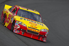 NASCAR:  Sep 18 Sylvania 300. LOUDON, NH - SEP 18, 2010:  Kevin Harvick brings his Pennzoil Shell Chevrolet through the turns during a practice session for the Stock Images