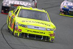 NASCAR:  Sep 18 Sylvania 300. LOUDON, NH - SEP 18, 2010:  Paul Menard brings his Sylvania Ford Fusion through the turns during a practice session for the Royalty Free Stock Image