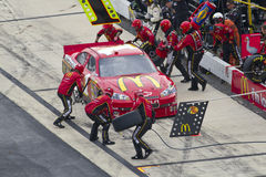 NASCAR:  Sep 26 AAA 400. DOVER, DE - SEP 26, 2010:  Jamie McMurray brings his McDonalds Chevrolet in for service during the AAA 400 race at the Dover Stock Image