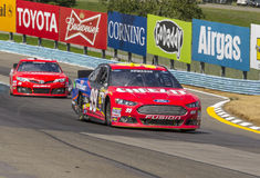 NASCAR 2013:  Sprint ahueca serie Cheez-él 355 en Glen August Foto de archivo