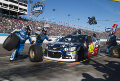 NASCAR Sprint Cup Driver Jimmie Johnson Pitstop. Experienced pit crew tends to five time NASCAR Sprint Cup Champion Driver Jimmie Johnson's number 48 race car at royalty free stock photo