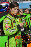 NASCAR Sprint Cup and Nationwide Danica Patrick. NASCAR race driver Danica Patrick inserts her radio earpieces prior to the AdvoCare 500 Sprint Cup Series race Royalty Free Stock Photos
