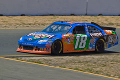 NASCAR Sprint Cup Series race. SONOMA, CA - JUNE 26: Kyle Busch (18) at speed during 2011 Toyota/Save Mart 350 Commercial, the NASCAR Sprint Cup Series race on Stock Image