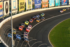 NASCAR - Stacked Up in Turn 3. NASCAR competitors, including Jeff Gordon, Tony Stewart and Carl Edwards, roll through turn 3 during the 2008 Coca Cola 600 at stock photos