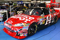 NASCAR - Stewart's Office Depot Old Spice Car. NASCAR Sprint Cup driver and owner Tony Stewart's #14 Office Depot Old Spice Chevy Impalain his garage stall Royalty Free Stock Photo