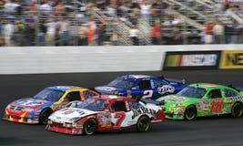NASCAR - una lotta delle 4 automobili! Fotografie Stock