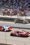 NASCAR vehicles and stadium Stock Image