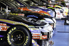 NASCAR - Winners Row. A shot of NASCAR All Star competitor's cars in the garage area heading to inspection before the 2010 NASCAR All Star race at Charlotte royalty free stock images