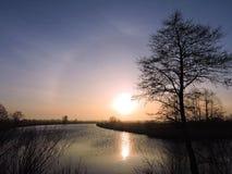 Nascer do sol colorido, Lituânia Fotos de Stock