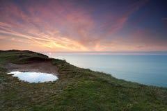 Nascer do sol colorido no mar Fotografia de Stock Royalty Free