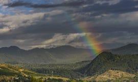 Nascer do sol com arco-íris Imagem de Stock