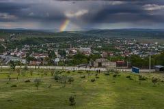 Nascer do sol com arco-íris Fotografia de Stock