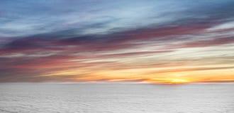 Nascer do sol com nuvens Imagem de Stock