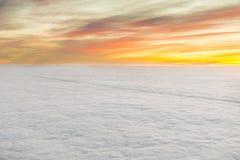 Nascer do sol com nuvens Imagens de Stock Royalty Free