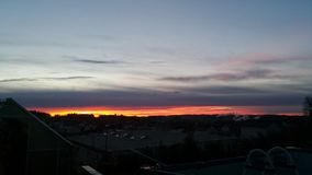 Nascer do sol com nuvens escuras Imagem de Stock Royalty Free