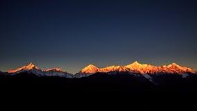 Nascer do sol de Meri Snow Mountain Fotos de Stock Royalty Free