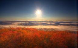 Nascer do sol de uma torre de fogo Fotografia de Stock