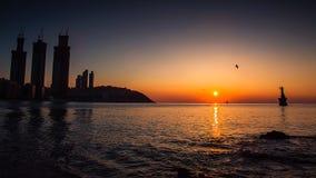 Nascer do sol e lighthouese Imagens de Stock