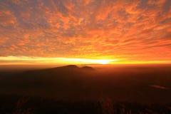 Nascer do sol e névoa Foto de Stock Royalty Free