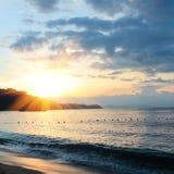 Nascer do sol e praia Imagem de Stock