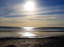 Nascer do sol em cima da praia fotografia de stock royalty free