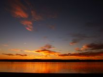 Nascer do sol em um lago fotos de stock