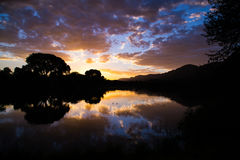 Nascer do sol espelhado Fotos de Stock Royalty Free