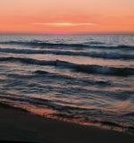 Nascer do sol na praia no porto Washington Foto de Stock