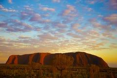 Nascer do sol na rocha de Ayer Imagem de Stock