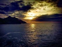 Nascer do sol nebuloso Imagem de Stock