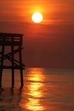 Nascer do sol no cais Imagens de Stock Royalty Free