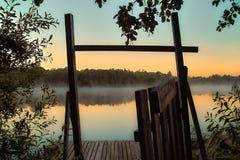 Nascer do sol no lago Imagem de Stock Royalty Free